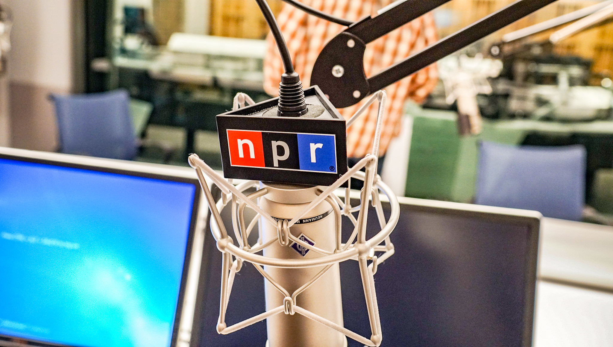 A mic with the NPR (National Public Radio) flag at their headquarters in Washington DC.